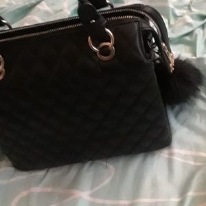 Black purse with free puff key chain